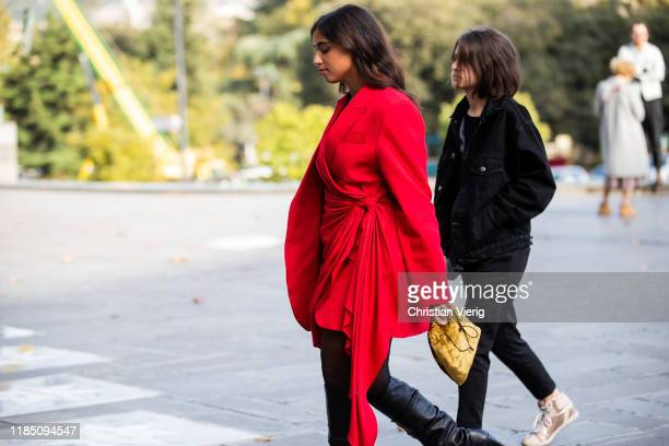 Guest is seen wearing red wrapped blazer, yellow vevelt bag during day 3 of the Mercedes-Benz Tbilisi Fashion Week on November 02, 2019 in Tbilisi,...