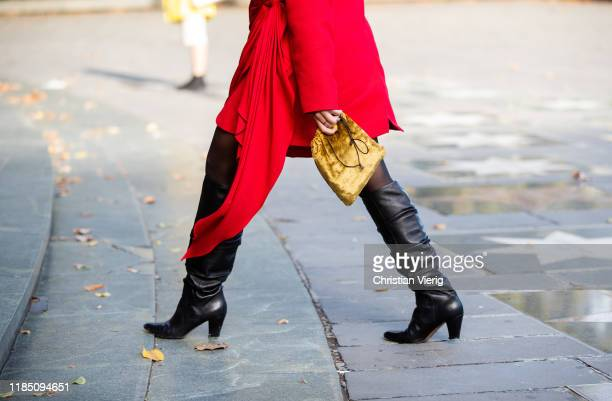 A guest is seen wearing red wrapped blazer yellow vevelt bag during day 3 of the MercedesBenz Tbilisi Fashion Week on November 02 2019 in Tbilisi...