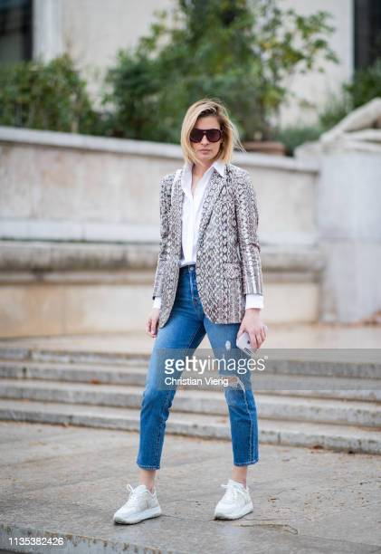 A guest is seen wearing ripped denim jeans outside Tods lunch during Paris Fashion Week Womenswear Fall/Winter 2019/2020 on March 05 2019 in Paris...