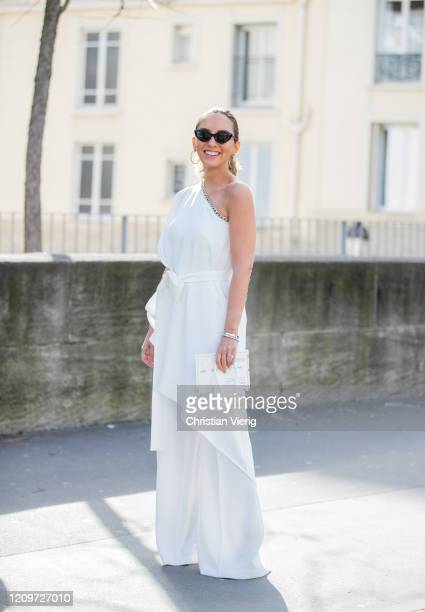 Guest is seen wearing ripped off white dress and wide leg pants outside Elie Saab during Paris Fashion Week - Womenswear Fall/Winter 2020/2021 : Day...
