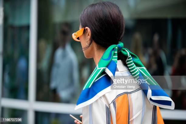 Guest is seen wearing scarf outside Holzweiler during Copenhagen Fashion Week Spring/Summer 2020 on August 07, 2019 in Copenhagen, Denmark.