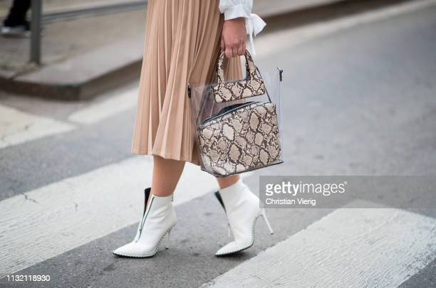 A guest is seen wearing see through bag with snake print outside Dolce Gabbana on Day 5 Milan Fashion Week Autumn/Winter 2019/20 on February 24 2019...