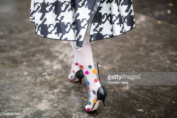 A guest is seen wearing see trough boots with dots print Prada white socks outside Stephane Rolland during Haute Couture Spring Summer 2019 Day Two...