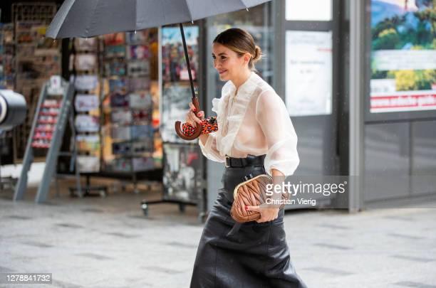 Guest is seen wearing sheer top, black high waist skirt, Miu Miu bag outside Miu Miu lunch during Paris Fashion Week - Womenswear Spring Summer 2021...