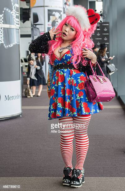A guest is seen wearing shoes by Irregular Choice with an ensemble of thriftstore and vntage clothes during the Mercedes Benz Fashion Week TOKYO 2015...