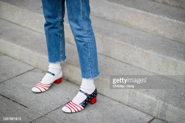 A guest is seen wearing shoes with the American flag during MercedesBenz Tbilisi Fashion Week on November 5 2018 in Tbilisi Georgia