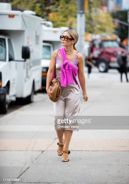 A guest is seen wearing silk dress outside Sally LaPointe during New York Fashion Week September 2019 on September 10 2019 in New York City