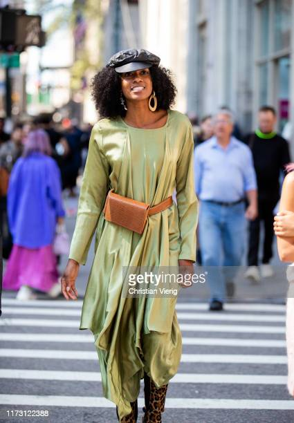 A guest is seen wearing silk dress outside SelfPortrait during New York Fashion Week September 2019 on September 07 2019 in New York City