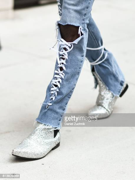 A guest is seen wearing silver boots outside the Matiere show during New York Fashion Week Men's S/S 2018 at Skylight Clarkson Sq on July 12 2017 in...