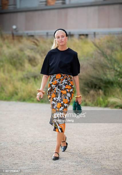 A guest is seen wearing skirt with floral print outside Samsøe Samsøe during Copenhagen Fashion Week Spring/Summer 2020 on August 07 2019 in...