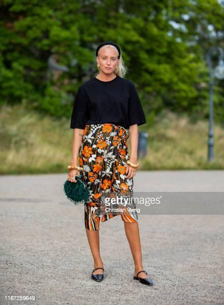 Guest is seen wearing skirt with floral print outside Samsøe & Samsøe during Copenhagen Fashion Week Spring/Summer 2020 on August 07, 2019 in...