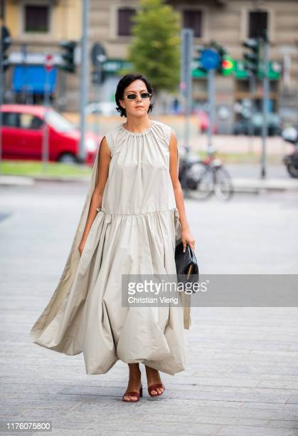 A guest is seen wearing sleeveless dress outside the Sportmax show during Milan Fashion Week Spring/Summer 2020 on September 20 2019 in Milan Italy