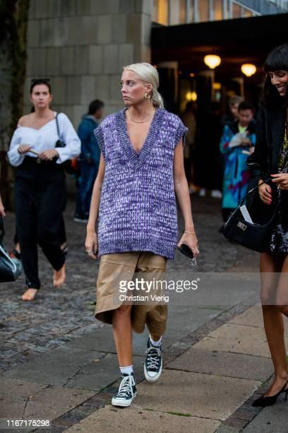 A guest is seen wearing sleeveless knit outside Saks Potts during Copenhagen Fashion Week Spring/Summer 2020 on August 08 2019 in Copenhagen Denmark