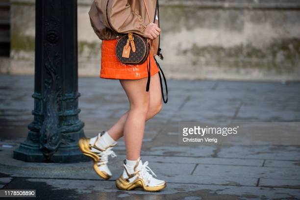 Guest is seen wearing sneakers and round bag outside Louis Vuitton during Paris Fashion Week Womenswear Spring Summer 2020 on October 01, 2019 in...