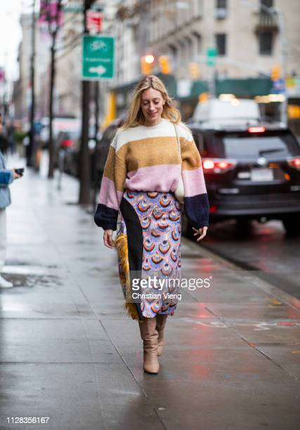 A guest is seen wearing striped knit multi colored skirt with print outside Nanushka during New York Fashion Week Autumn Winter 2019 on February 08...