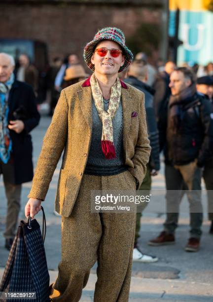 A guest is seen wearing suit during Pitti Uomo 97 at Fortezza Da Basso on January 08 2020 in Florence Italy