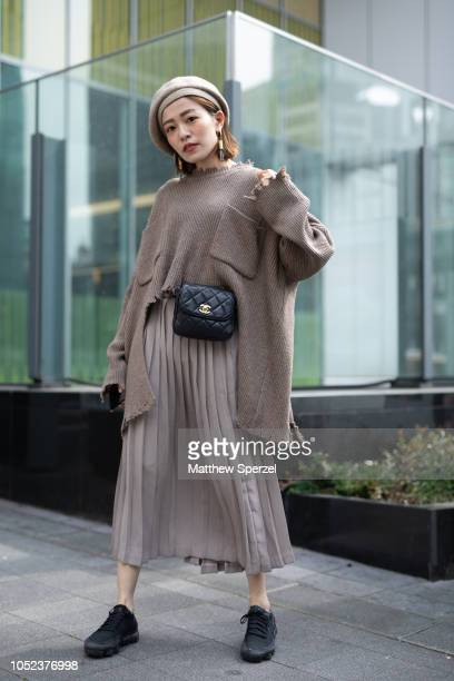 A guest is seen wearing taupe outfit with beret and black Chanel hip belt bag during the Amazon Fashion Week TOKYO 2019 S/S on October 16 2018 in...