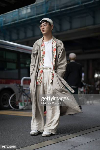 A guest is seen wearing taupe outfit with floral scarf during the Amazon Fashion Week TOKYO 2018 A/W on March 24 2018 in Tokyo Japan
