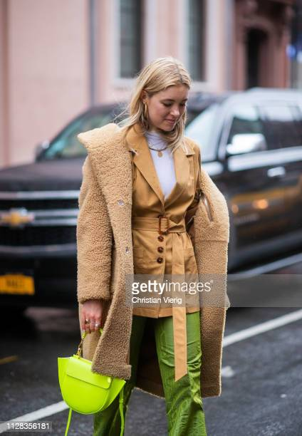 A guest is seen wearing teddy coat neon bag beige blazer outside Nanushka during New York Fashion Week Autumn Winter 2019 on February 08 2019 in New...