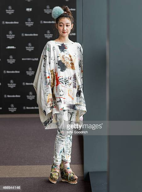 A guest is seen wearing top and trousers by Hiro and shoes by Undercover during the Mercedes Benz Fashion Week TOKYO 2015 A/W at Shibuya Hikarie on...
