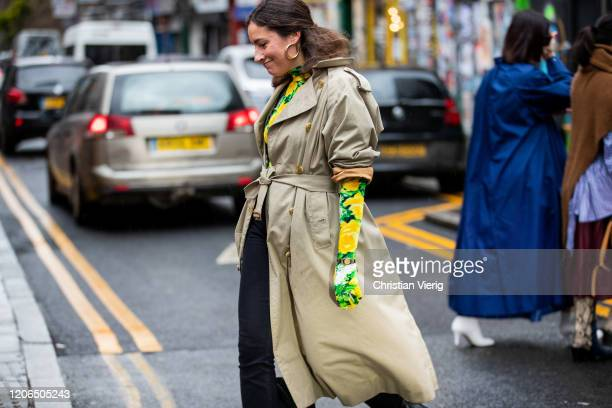 A guest is seen wearing top with gloves and floral print outside Marques Almeida during London Fashion Week February 2020 on February 15 2020 in...