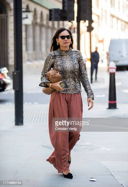 A guest is seen wearing top with snake print outside David Koma during London Fashion Week September 2019 on September 15 2019 in London England