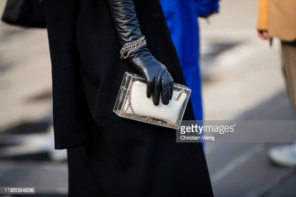 Guest is seen wearing transparent bag during day 3 of the Mercedes-Benz Tbilisi Fashion Week on November 02, 2019 in Tbilisi, Georgia.
