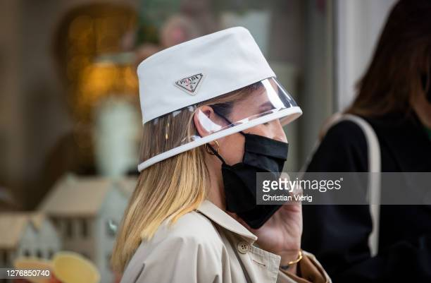A guest is seen wearing transparent Prada hat outside Drome during the Milan Women's Fashion Week on September 26 2020 in Milan Italy