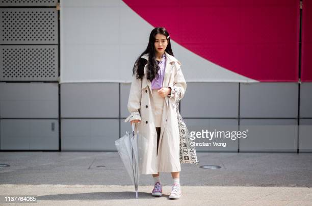 A guest is seen wearing trench coat at the Hera Seoul Fashion Week 2019 F/W at Dongdaemun Design Plaza at Dongdaemun Design Plaza on March 23 2019 in...