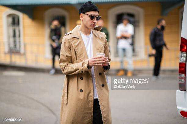A guest is seen wearing trench coat during MercedesBenz Tbilisi Fashion Week on November 3 2018 in Tbilisi Georgia