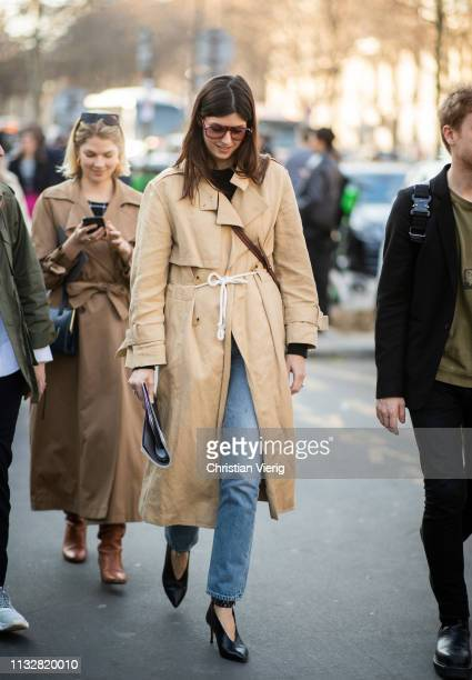 A guest is seen wearing trench coat outside Dries van Noten during Paris Fashion Week Womenswear Fall/Winter 2019/2020 on February 27 2019 in Paris...