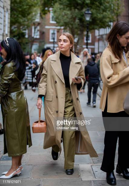 Guest is seen wearing trench coat outside Erdem during London Fashion Week September 2019 on September 16, 2019 in London, England.