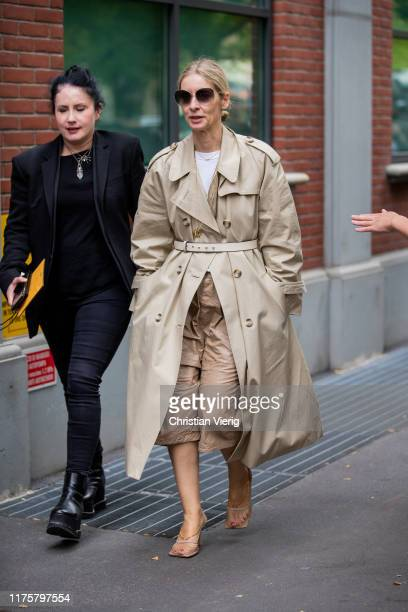 Guest is seen wearing trench coat outside the Fendi show during Milan Fashion Week Spring/Summer 2020 on September 19, 2019 in Milan, Italy.
