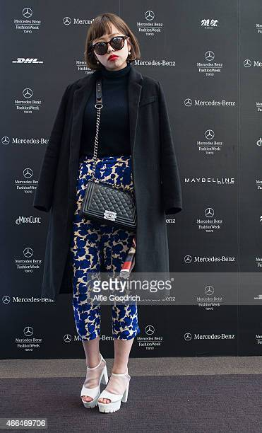 A guest is seen wearing trousers by HM and bag by Chanel during the Mercedes Benz Fashion Week TOKYO 2015 A/W at Shibuya Hikarie on March 16 2015 in...