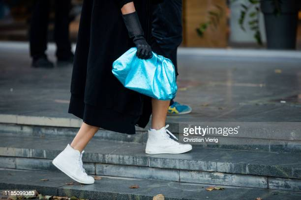 Guest is seen wearing turquois Bottega Veneta pouch bag during day 3 of the Mercedes-Benz Tbilisi Fashion Week on November 02, 2019 in Tbilisi,...