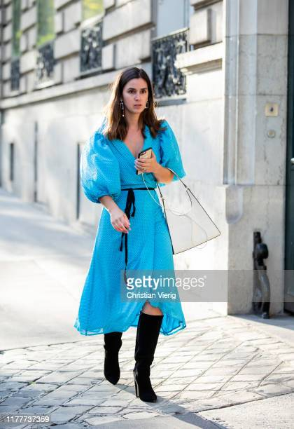 A guest is seen wearing turquois dress outside Alessandra Rich during Paris Fashion Week Womenswear Spring Summer 2020 on September 27 2019 in Paris...