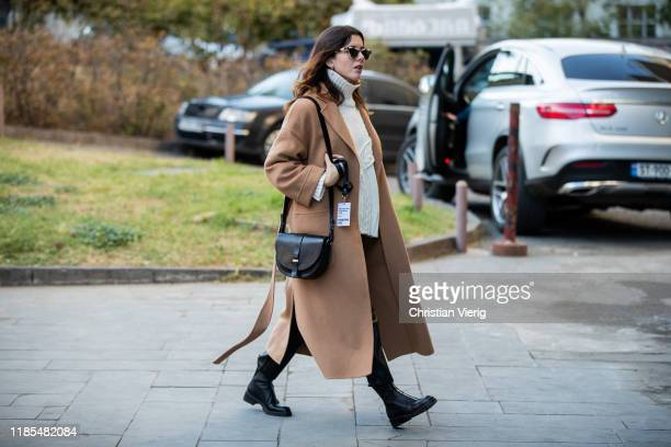 A guest is seen wearing turtleneck brown coat during day 4 of the MercedesBenz Tbilisi Fashion Week on November 03 2019 in Tbilisi Georgia