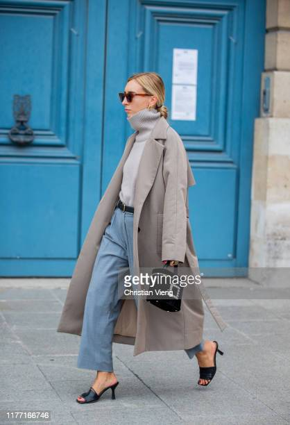 A guest is seen wearing turtleneck grey coat outside Guy Laroche during Paris Fashion Week Womenswear Spring Summer 2020 on September 25 2019 in...