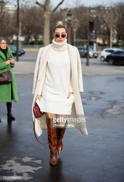 Guest is seen wearing turtleneck knit, creme white coat, brown boots outside Chanel during Paris Fashion Week - Womenswear Fall/Winter 2020/2021 :...