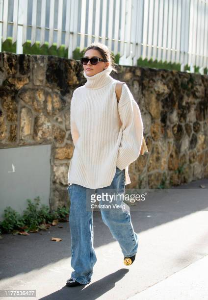 A guest is seen wearing turtleneck knit ripped denim jeans outside Loewe during Paris Fashion Week Womenswear Spring Summer 2020 on September 27 2019...