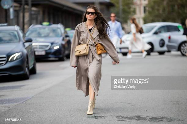 A guest is seen wearing two Chanel bags outside Holzweiler during Copenhagen Fashion Week Spring/Summer 2020 on August 07 2019 in Copenhagen Denmark
