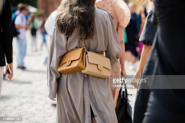 A guest is seen wearing two Chanel bags outside Rodebjer during Copenhagen Fashion Week Spring/Summer 2020 on August 07 2019 in Copenhagen Denmark