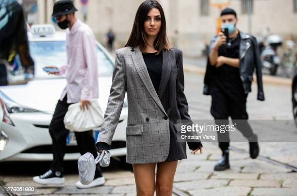 Guest is seen wearing two tone blazer outside Simona Marziali during the Milan Women's Fashion Week on September 23, 2020 in Milan, Italy.