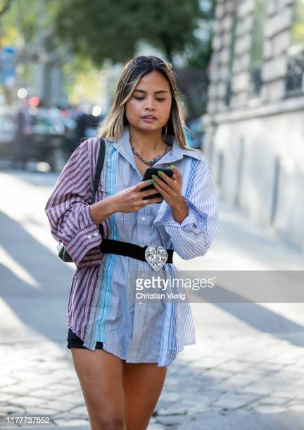 Guest is seen wearing two tone button shirt outside Alessandra Rich during Paris Fashion Week Womenswear Spring Summer 2020 on September 27, 2019 in...