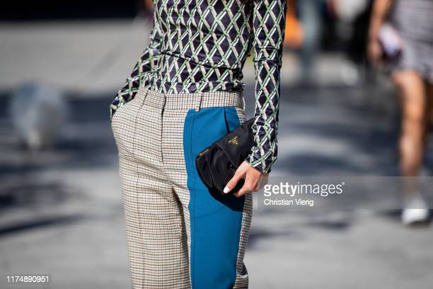 A guest is seen wearing two tone pants outside Preen during London Fashion Week September 2019 on September 15 2019 in London England