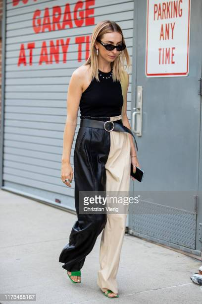 A guest is seen wearing two tone pants outside Zimmermann during New York Fashion Week September 2019 on September 09 2019 in New York City