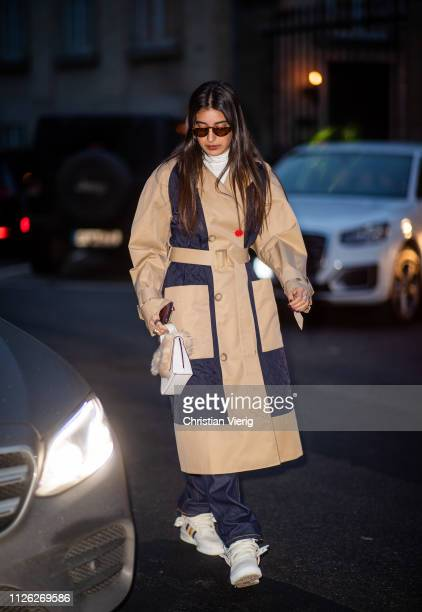 A guest is seen wearing two tone trench coat outside Stine Goya during the Copenhagen Fashion Week Autumn/Winter 2019 Day 2 on January 30 2019 in...