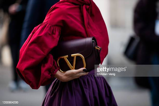 Guest is seen wearing Valentino bag outside Ralph & Russo during Paris Fashion Week - Haute Couture Spring/Summer 2 020 on January 20, 2020 in Paris,...