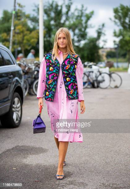 A guest is seen wearing vest with floral print pink dress purple Boyy bag outside Blanche during Copenhagen Fashion Week Spring/Summer 2020 on August...