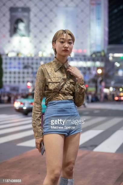 A guest is seen wearing vintage gold pattern shirt blue shorts grey kneehigh shoes during the Amazon Fashion Week TOKYO 2019 A/W on March 21 2019 in...